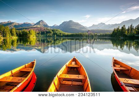 poster of Wonderful mountain lake in National Park High Tatra. Location place Strbske pleso, Slovakia, Europe.