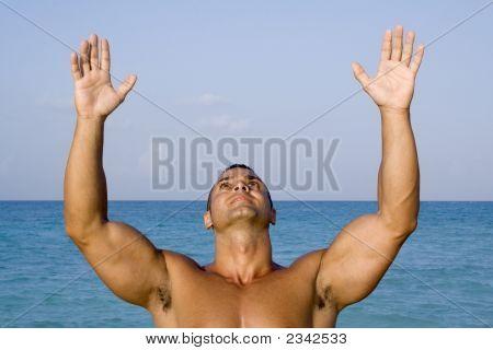Young Man Meditating Near Ocean