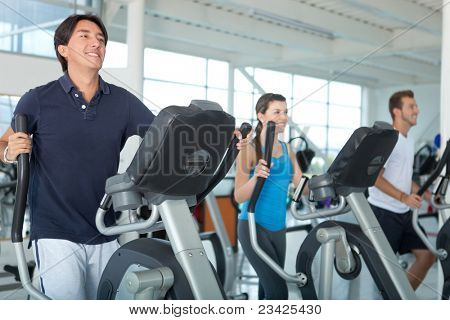 Group of people at the gym exercising on the xtrainer machines