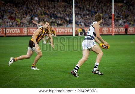 MELBOURNE - SEPTEMBER 9 : Mitch Duncan (R) kicks during Geelong's win over Hawthorn - September 9, 2011 in Melbourne, Australia.