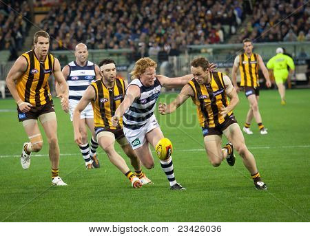 MELBOURNE - SEPTEMBER 9 : Brad Sewell (R) is tackled by Cameron Ling during  Geelong's win over Hawthorn - September 9, 2011 in Melbourne, Australia.