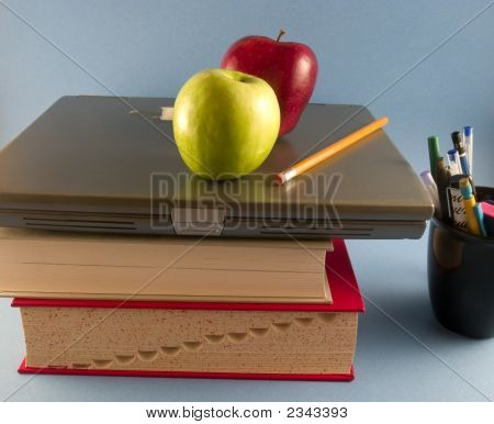 Apples With Books, Laptop And Pens