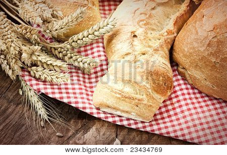 bread variety on wooden background