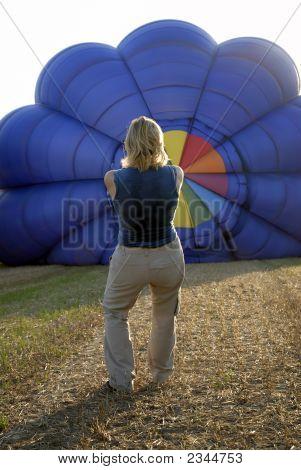 Balloonist Inflating Balloon