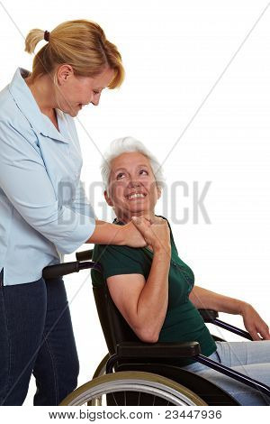Extended Care Nurse Helping Senior Woman