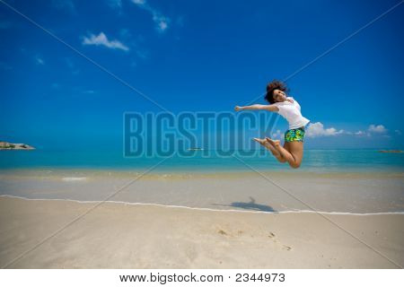 Happy Jump At The Beach