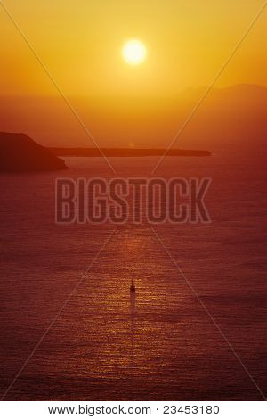 An image of a beautiful sunset over the ocean Santorini