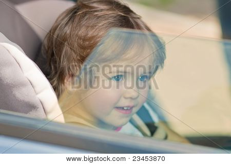 Kid Looking Across A Window Pane Smiling