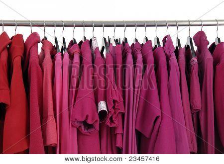 Designer fashion red clothing on hangers