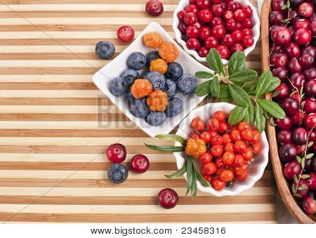 Fresh berries in a  wooden striped surface
