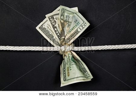 money knotted with rope