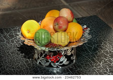 Metal Vase Of Different Fruits On Table