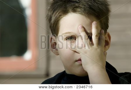 Boy With A Hand In Front Of His Face