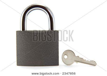 Closed Padlock And Key.