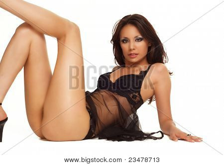 Beautiful sexy slim latina model wearing black lingerie isolated against white background