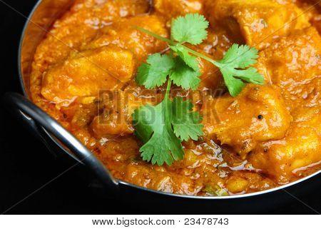 Indian chicken dansak curry in balti dish.