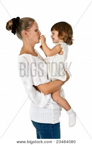 Little Girl At The Hands Of The Mother Feeds Her And Plum