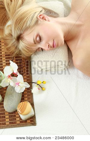 Top view of a relaxed young woman at spa salon