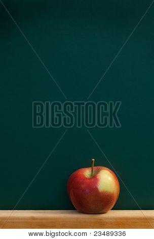 Red Apple On Chalkboard