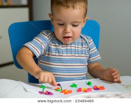 Boy And Flowers Of Plasticine