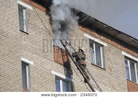 Fireman Extinguish A Fire  In A High-Rise Apartment