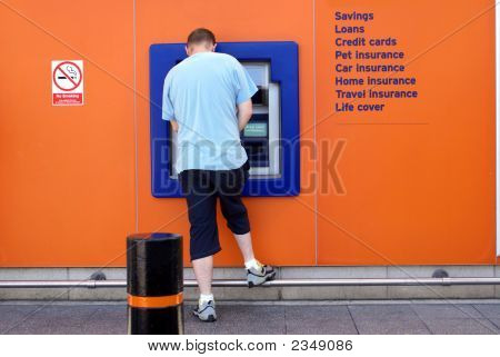 Man Using Cash Machine/Atm