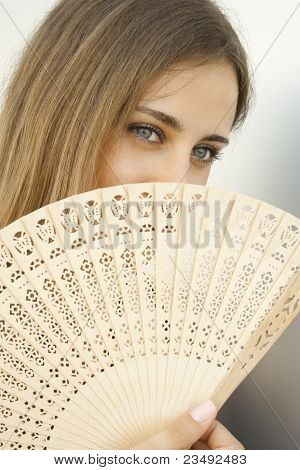 Beautiful Young Woman With A Fan