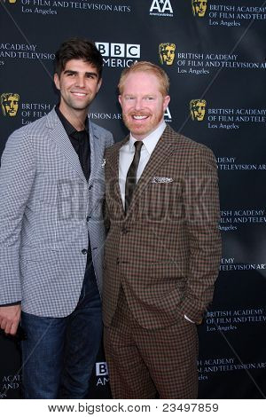 LOS ANGELES - SEP 17:  Justin Mikita, Jesse Tyler Ferguson arrives at the 9th Annual BAFTA Los Angeles TV Tea Party. at L'Ermitage Beverly Hills Hotel on September 17, 2011 in Beverly Hills, CA