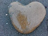 Big Sea Pebble Stone Or Rock In Heart Shape As Frame On Beach. Pebble Stone Heart Natural Abstract T poster