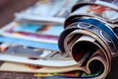 Close-up Of Stack Of Colorful Magazines. Press News And Magazines Concept poster