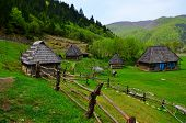 Old Wooden Houses. Traditional Old Wooden House In Carpathian Mountains. Dirt Road Leading To Lonely poster