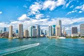 Aerial View Of Miami Skyscrapers With Blue Cloudy Sky,white Boat Sailing Next To Miami Florida Downt poster