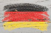 Flag Of Germany On Grunge Wooden Texture Painted With Chalk
