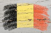 Flag Of Belgium On Grunge Wooden Texture Painted With Chalk