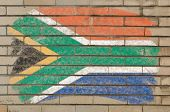 Flag Of South Africa On Grunge Brick Wall Painted With Chalk