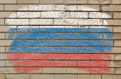 Flag Of Russia On Grunge Brick Wall Painted With Chalk
