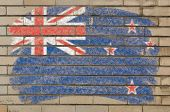 Flag Of New Zealand On Grunge Brick Wall Painted With Chalk