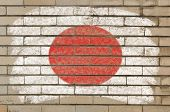 Flag Of Japan On Grunge Brick Wall Painted With Chalk