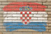 Flag Of Croatia On Grunge Brick Wall Painted With Chalk