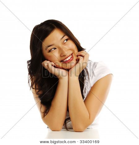 Asian Business Woman With Elbows On White Block
