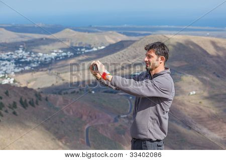 Man photographing view