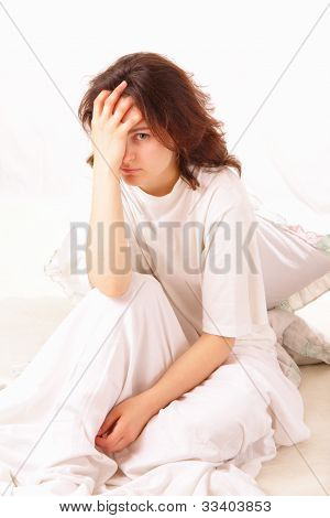 Sick Young Woman Sitting In Bed