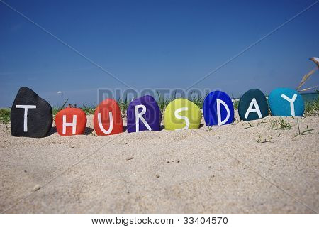 Thursday, fourth day of the week on colourful stones