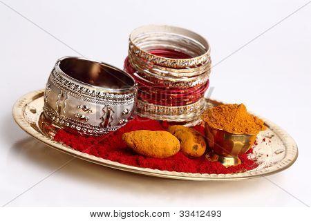 turmeric and kumkum with bangles