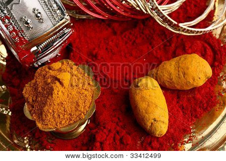 turmeric and kumkum with bangles