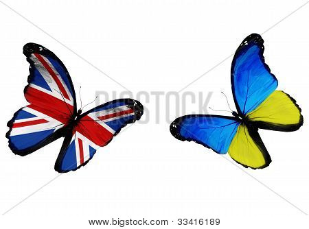 Concept - Two Butterflies With Ukrainian And English Flags Flying