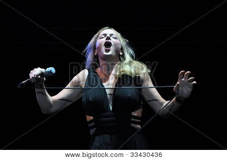 Vocalist woman performs live on the stage