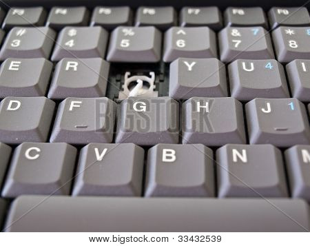Broken button on grey keyboard