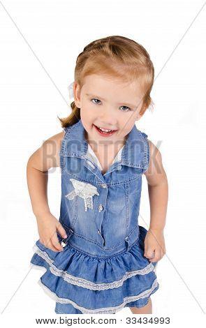 Portrait Of Cute Smiling Little Girl In Dress