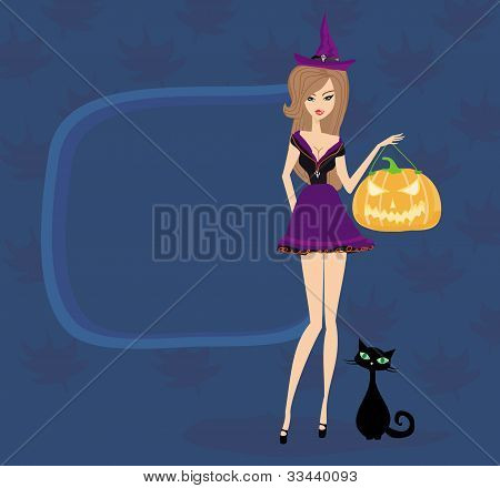 Halloween witch standing with pumpkin